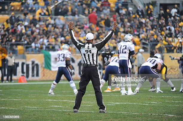 National Football League referee Mike Carey signals during a game between the New England Patriots and Pittsburgh Steelers at Heinz Field on October...