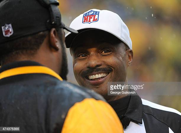 National Football League referee Mike Carey smiles as he talks to head coach Mike Tomlin of the Pittsburgh Steelers during a game against the...