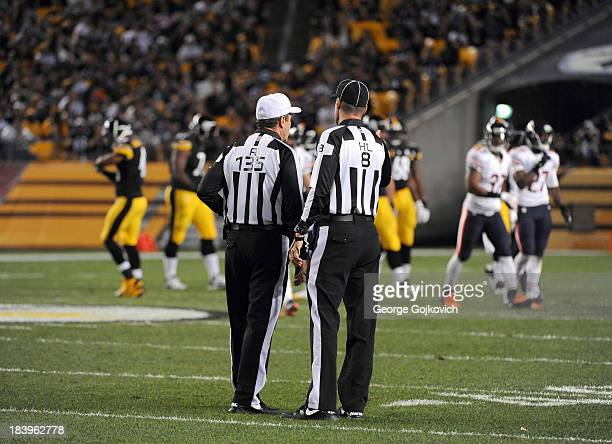National Football League referee Pete Morelli and head linesman Dana McKenzie confer during a game between the Chicago Bears and Pittsburgh Steelers...