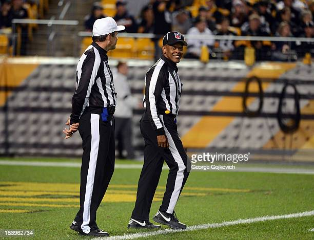 National Football League referee Pete Morelli and line judge Carl Johnson talk during a game between the Chicago Bears and Pittsburgh Steelers at...