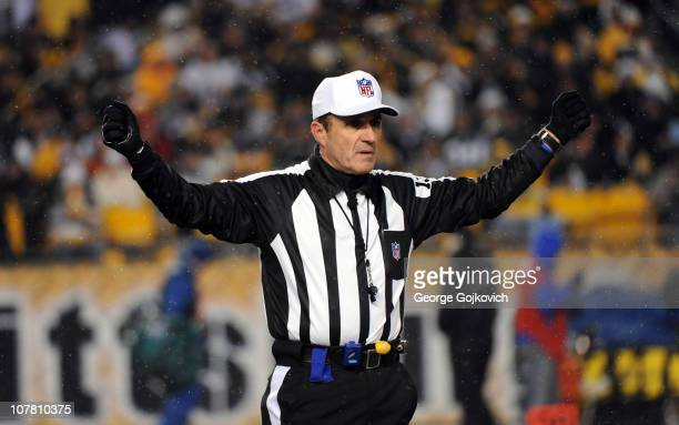 National Football League referee Pete Morelli signals during a game between the New York Jets and Pittsburgh Steelers at Heinz Field on December 19...