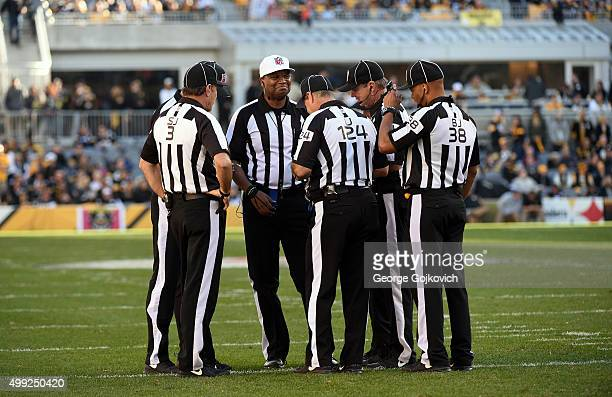 National Football League referee Ronald Torbert meets with other members of the officiating crew including side judge Scott Edwards umpire Carl...