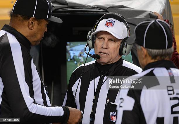9ff7aed2d32 National Football League referee Walt Anderson confers with line judge  Byron Boston and back judge Billy