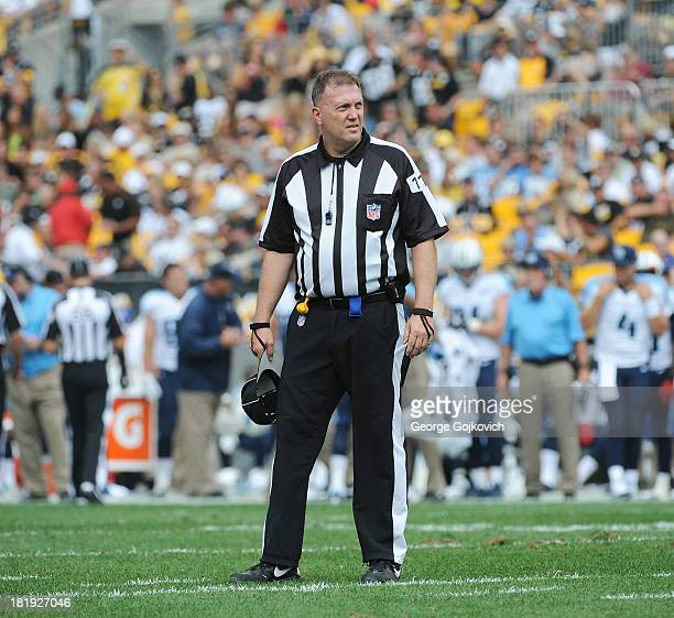 National Football League umpire Tony Michalek looks on from the field during a game between the Tennessee Titans and Pittsburgh Steelers at Heinz...