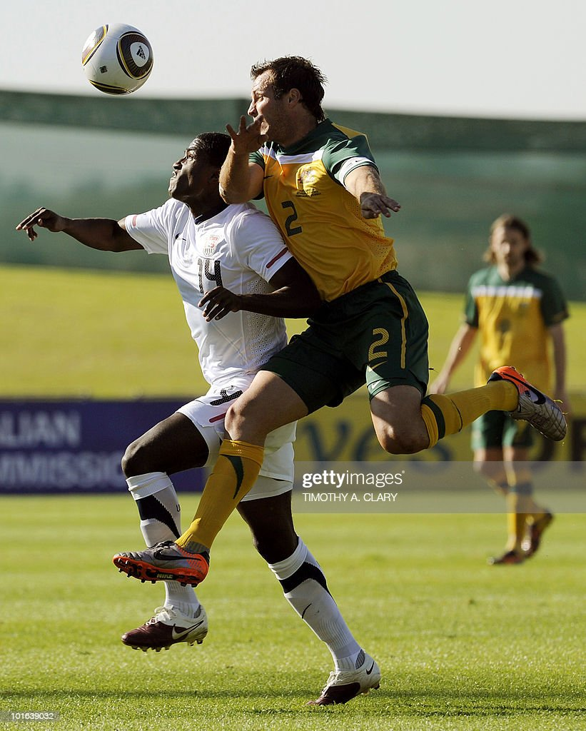 US National football player Edson Buddle and Lucas Neill from Australia vies for the ball during a friendly match at Ruimsig Stadium in Roodepoort, Johannesburg on June 5, 2010. The US National Team is in preparation for the 2010 FIFA World Cup.