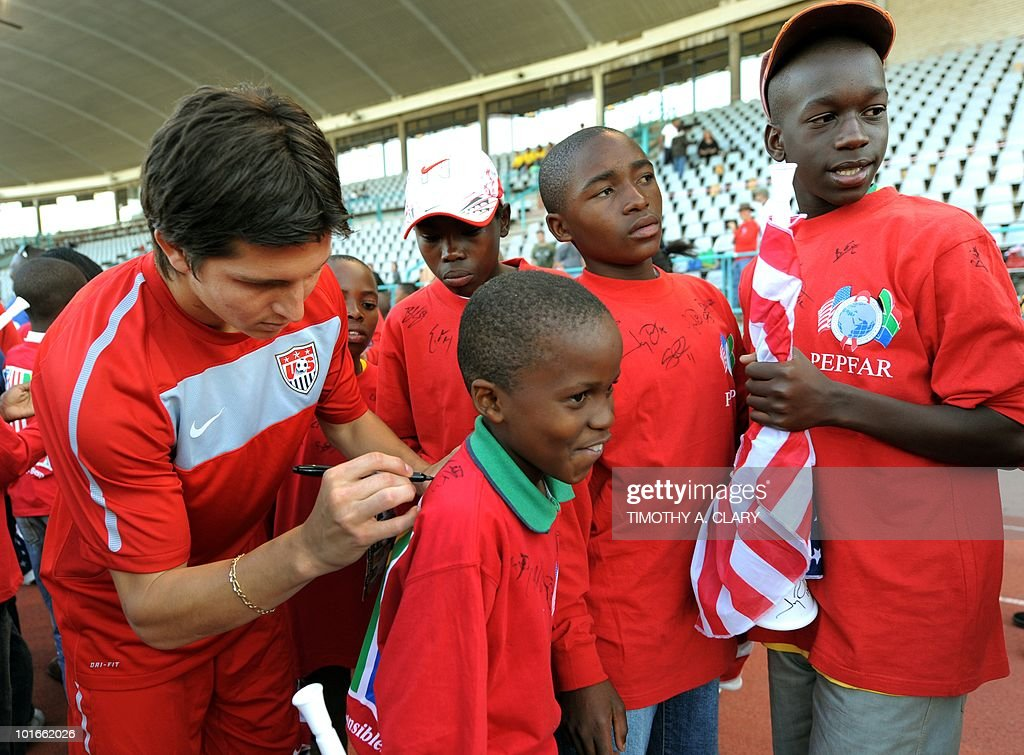 US national football team midfielder Jose Torres (L) signs autographs for local school children after a open training session for fans at Pilditch Stadium June 6, 2010. The US is preparing for their 1st game next week in the 2010 FIFA World Cup.