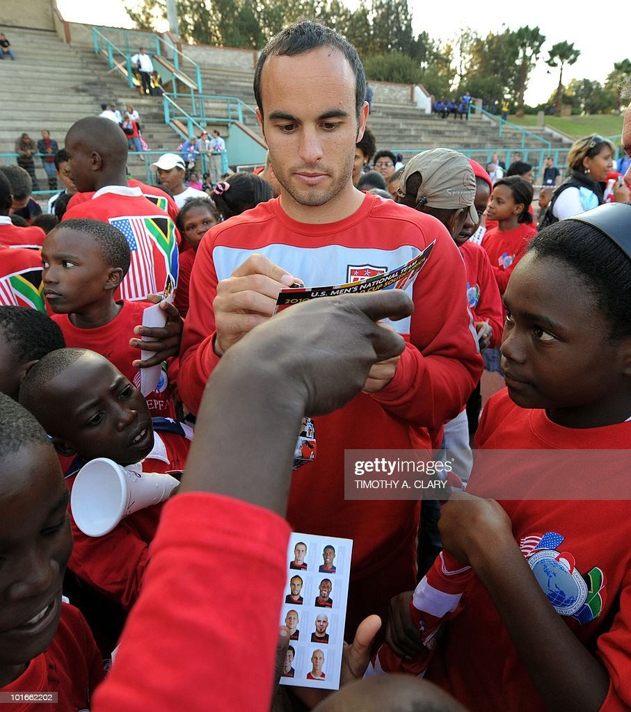 US national football team midfielder Landon Donovan signs autographs for local school children after an open training session for fans at Pilditch Stadium June 6, 2010. The US is preparing for their 1st game next week in the 2010 FIFA World Cup.