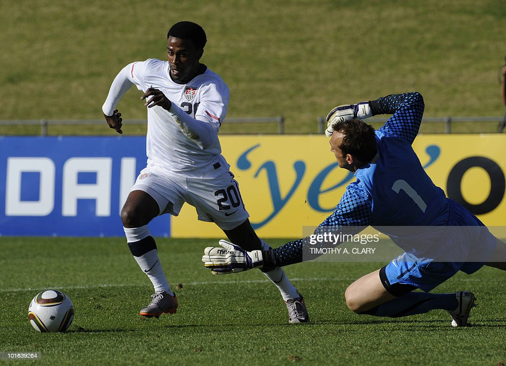 US national football team player Robbie Findley (L) and Australian national team goalkeeper Mark Schwarzer fight for the ball during a friendly match at the Ruimsig Stadium in Johannesburg on June 5, 2010. The US team is preparing for the 2010 FIFA World Cup.