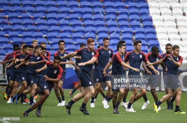 US national football team players take part in a training session on June 8 at the Groupama Stadium in DecinesCharpieu near Lyon centraleastern...