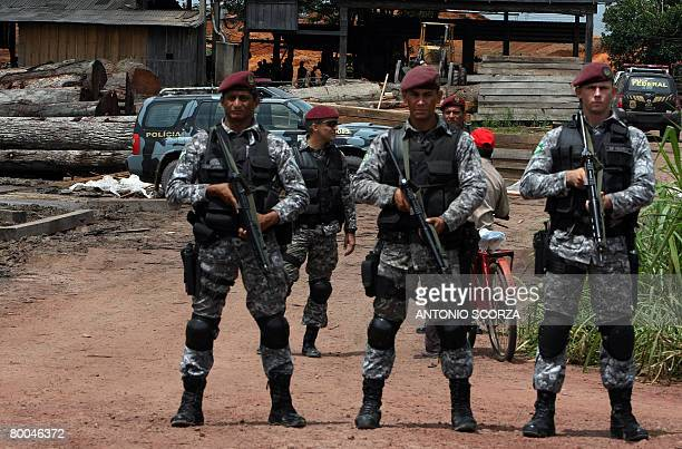 National Force agents secure the entrance of a clandestine sawmill in the border of the Amazon rain forest 70 km from Tailandia Para in northern...