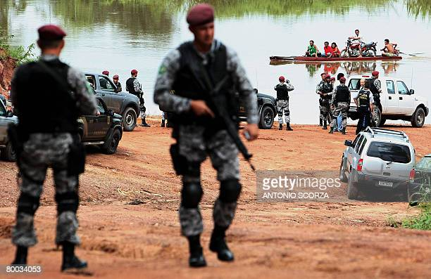 National Force and Federal Police personnel seize a port on the banks of the Moju river 80 Km from Tailandia in Para northen Brazil on February 27...