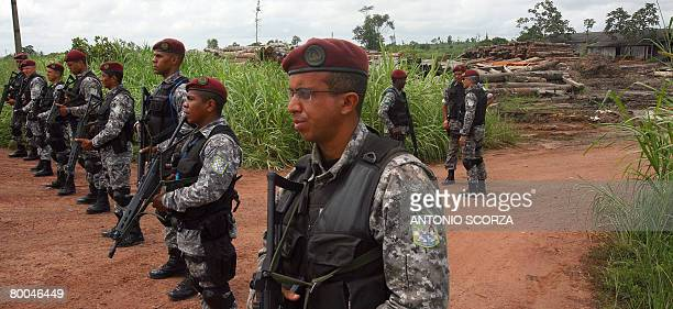 National Force personnel block the entrance to a suspicious sawmill in the outskirts of Tailandia Para northen Brazil on February 27 2008 The...