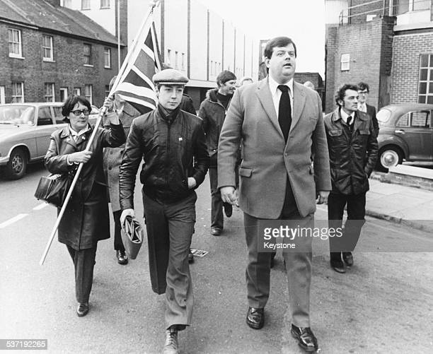 National Front leader Martin Webster leaving Kingston Crown Court with his followers where he was given a suspended sentence for publishing material...