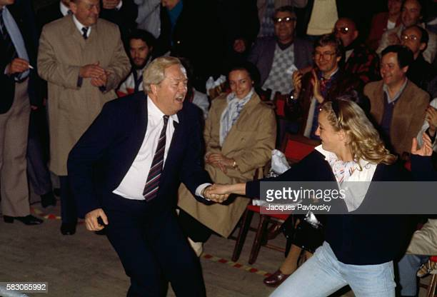 National Front President JeanMarie Le Pen dances with his daughter Marine at a political convention in Paris Earlier Le Pen who is also a member of...
