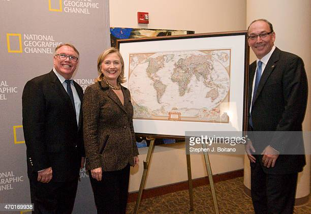 National Geographic Channel's EVP of Content Steve Burns and President Steve Schiffman present Secretary of State Hillary Clinton with a personalized...