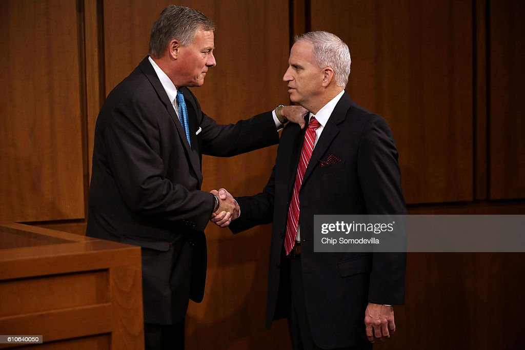 National Geospatial-Intelligence Agency Director Robert Cardillo (R) talks with Senate Select Committee on Intelligence Chairman Richard Burr (R-NC) before testifying to the committee in the Hart Senate Office Building on Capitol Hill September 27, 2016 in Washington, DC. This was the first time in the agency's 20 years that the director testified in an open hearing.