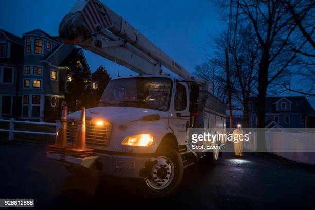 National Grid on scene of a downed highpower line on Landgrane St on March 7 2018 in Quincy Massachusetts Large portions of the East Coast are facing...