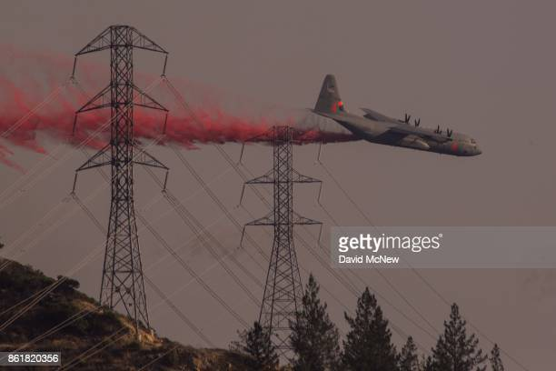 National Guard air tanker drops fire retardant during the Oakmont Fire on October 15, 2017 near Santa Rosa, California. At least 40 people were...