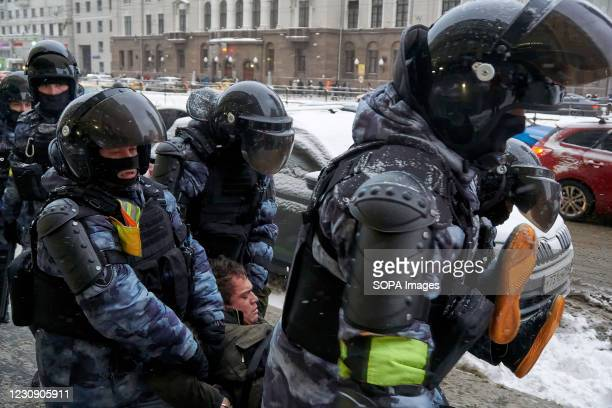 National Guard are seen carrying an aggressive protester on the street during the demonstration. More than five thousand people were detained during...