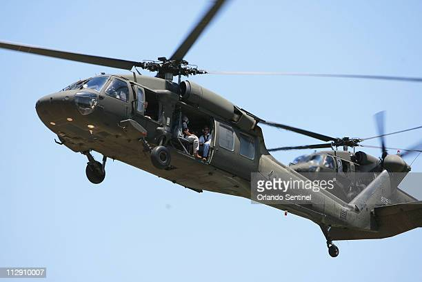 A National Guard Blackhawk helicopter carrying Florida Gov Charlie Crist prepares to land at the command post at Malabar Fire Station 99 Tuesday May...
