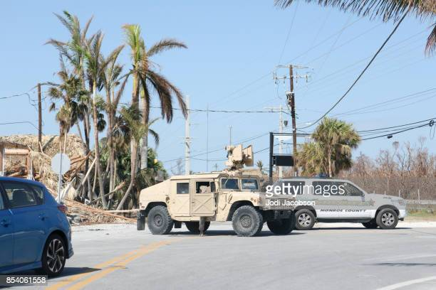 national guard blocking street in ramrod key, florida in the aftermath of a hurricane - national guard stock pictures, royalty-free photos & images