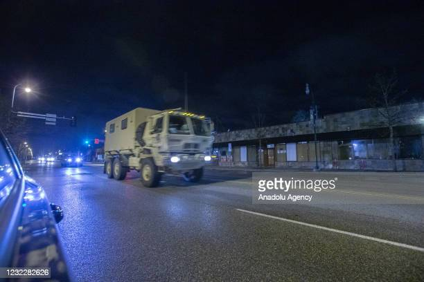 National Guard caravan drives down Lake Street as protests over police killing of Daunte Wright continue in Brooklyn Center, Minnesota, U.S., on...