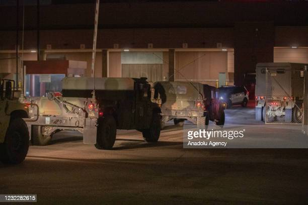 National Guard caravans arrive at the Convention Center where protesters were gathering as a staging area as protests over police killing of Daunte...