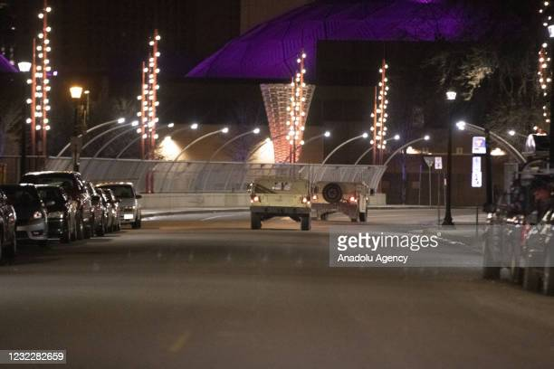 National Guard caravans drive through the streets of Minneapolis and to the Convention Center where protesters were gathering as a staging area as...