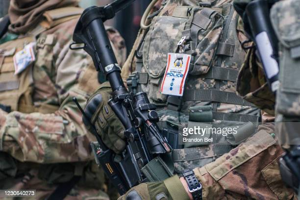 National Guard Citizen-soldier holds his weapon during a meeting downtown on January 17, 2021 in Washington, DC. After last week's riots at the U.S....