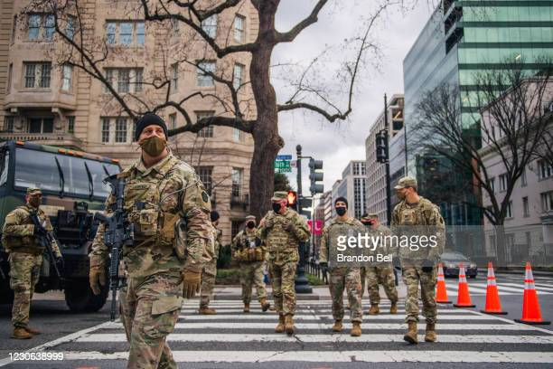 National Guard Citizen-soldiers walk the streets downtown on January 17, 2021 in Washington, DC. After last week's riots at the U.S. Capitol...