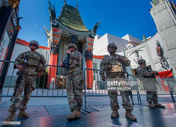 National Guard keep watch outside the TCL Chinese Theater on Hollywood Blvd after demonstrators continued to protest the death of George Floyd in...