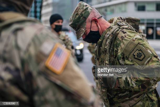 National Guard Lieutenant laughs with Guard Citizen-soldiers during a meeting downtown on January 17, 2021 in Washington, DC. After last week's riots...