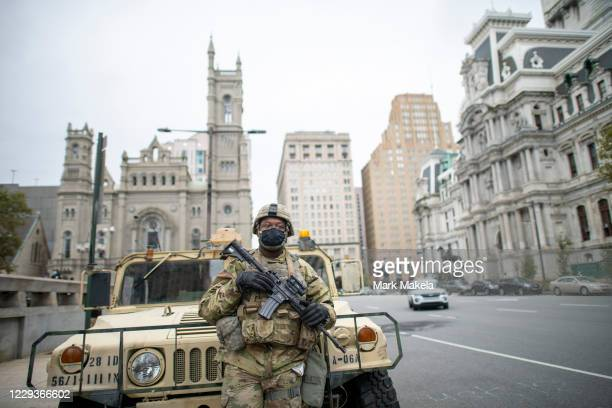 National Guard member Private First Class Clemens monitors activity surrounding Philadelphia City Hall on October 30, 2020 in Philadelphia,...