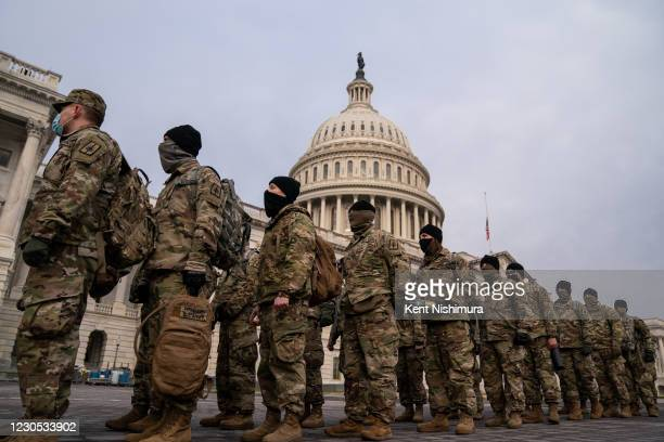National Guard member stage on the U.S. Capitol Building grounds, as heightened security measures are in place nearly a week after a pro-Trump...