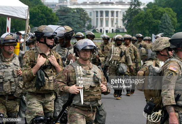 National Guard members deploy near the White House as peaceful protests are scheduled against police brutality and the death of George Floyd, on June...