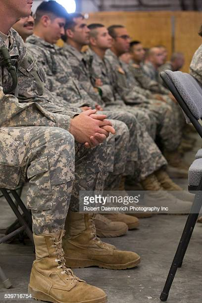 National Guard members listen to Texas Governor Rick Perry speak as he tours Texas Guard operations at Camp Swift east of Austin as troops prepare...