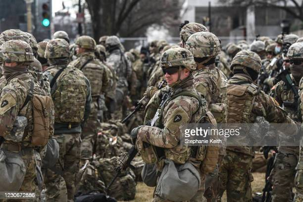 National Guard patrol the National Mall on January 19, 2021 in Washington, DC. Tight security measures are in place for Inauguration Day due to...