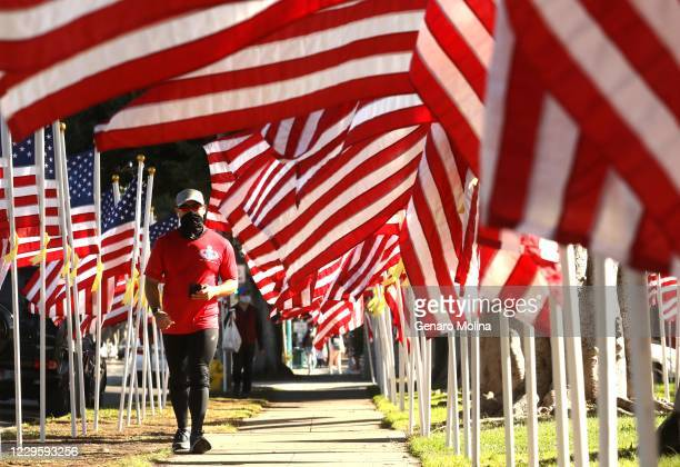 S National Guard Ryan Cho who recently came back from a tour in Afghanistan makes his way past a Tribute to Heroes in honor of Veterans Day along...