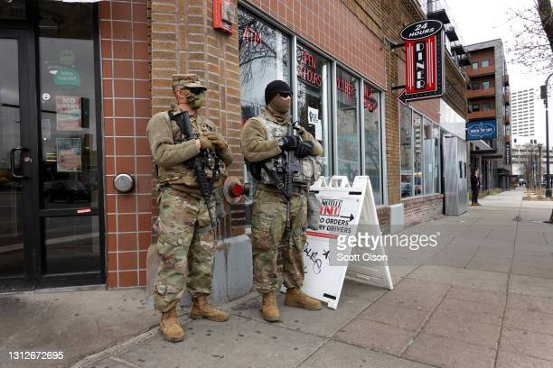 National guard soldier are posted on a street corner near downtown as the city prepares for reaction to the verdict in the Derek Chauvin trial on...