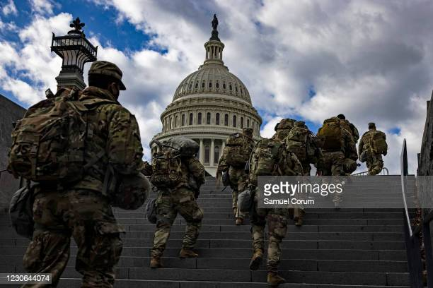 National Guard soldier head to the east front of the U.S. Capitol from the Capitol Visitors Center on January 17, 2021 in Washington, DC. After last...