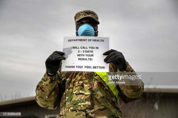 National Guard soldier informs patients at a coronavirus testing center at Lehman College on March 28, 2020 in the Bronx, New York City. The center,...