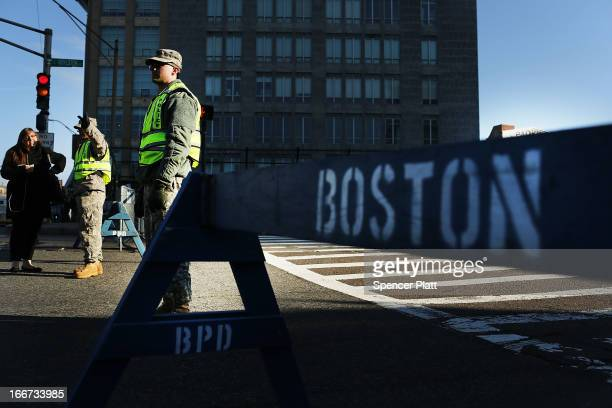 National Guard soldiers guard a roadblock near the scene of a twin bombing at the Boston Marathon on April 16 2013 in Boston Massachusetts The twin...
