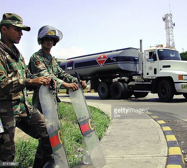 National Guard soldiers guard the entrance and exit of Bajo Grande in the city of Maracaibo 250 kms west of Caracas 09 April 2002 The state owned...