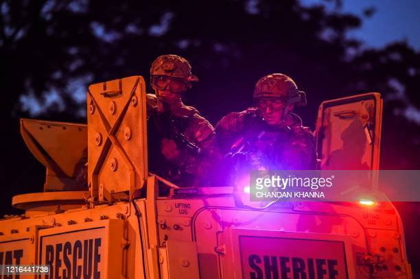 US National Guard soldiers patrol near the 5th police precinct during a demonstration to call for justice for George Floyd a black man who died while...