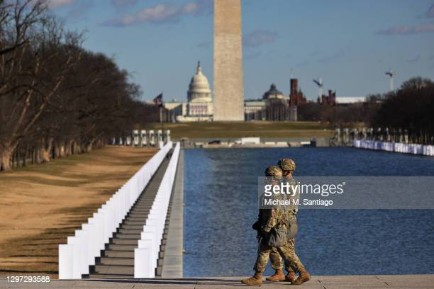 National Guard soldiers patrol the grounds of the Lincoln Memorial ahead of President-elect Joe Biden and Vice President-elect Kamala Harris...
