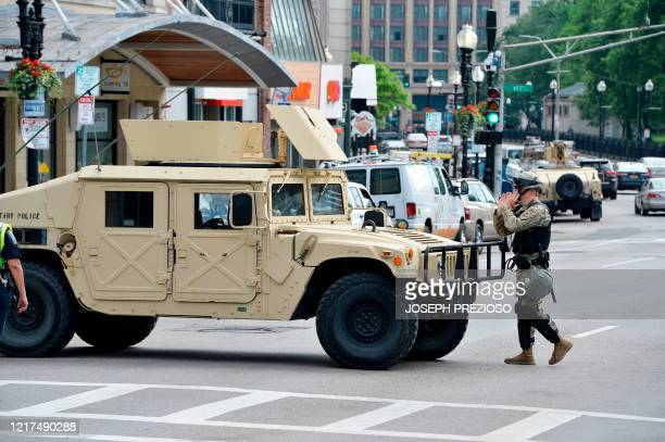 National Guard soldiers place armoured vehicles and soldiers around the city in Boston, Massachusetts on June 3, 2020. - Anti-racism protests have...