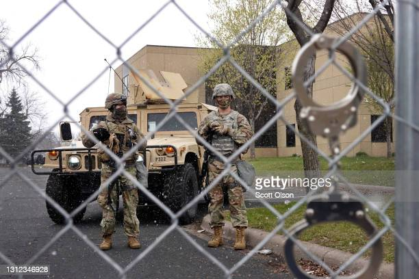 National Guard soldiers stand guard outside of the Brooklyn Center police station on April 13, 2021 in Brooklyn Center, Minnesota. Demonstrators,...