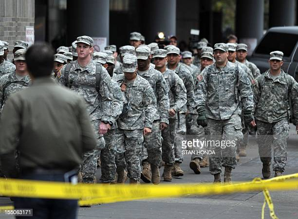 National Guard soldiers walk to Bellevue Hospital during a planned evacuation of the hospital October 31 2012 in New York Bellevue Hospital the...
