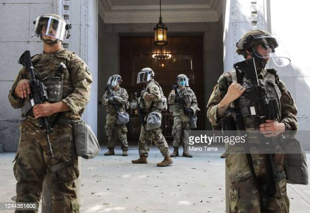 National Guard troops are posted outside the District Attorney's office during a peaceful demonstration over George Floyd's death on June 3 2020 in...