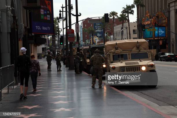 National Guard troops arrive in front of Grauman's Chinese Theatre branded as TCL Chinese Theatre at the Hollywood Walk of Fame after California...